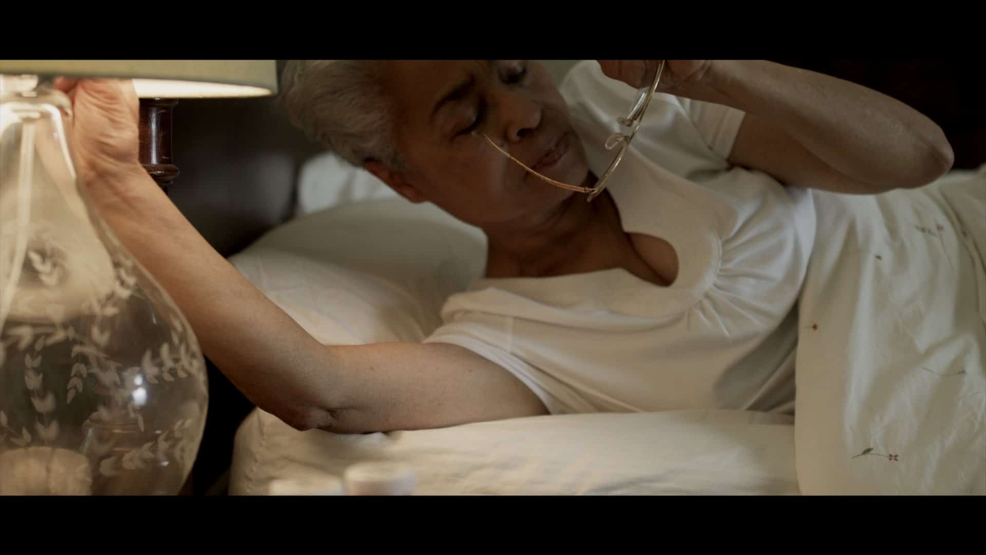 old lady waking series of library shots 4k RED shooting and davinici resolve color correction